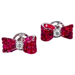 18 Karat White Gold Ruby Stud Invisible Ribbon Earrings
