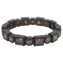 18k Gold, Black Rhodium, Eternity Band is Bezel Set with 1.02 carat of Diamond