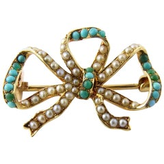14 Karat Yellow Gold Seed Pearl and Turquoise Bow Brooch/Pin