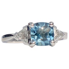Aquamarine Cushion Cut With White Trilliant Diamond Shoulders Engagement Ring