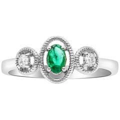 0.21 Carat Oval Emerald and Diamond Ring