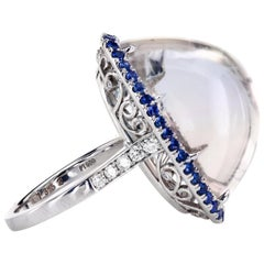 33.3 Carat Bi-Color Cabochon Topaz Platinum Ring Blue Sapphire Pave and Diamonds