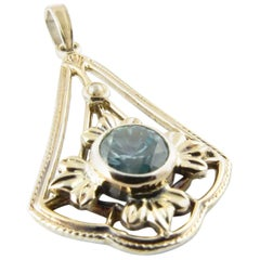 12 Karat White Gold and Sterling Silver Blue Gemstone Pendant