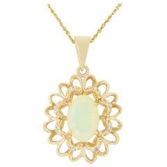 1.45 Carat Oval Shaped Opal and Diamond Pendant