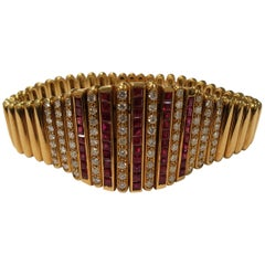 18 Karat Yellow Gold Salavetti Bracelet with Invisible Set Rubies and Diamonds