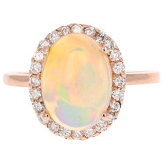 2.95 Carat Oval Cut Opal Diamond 14 Karat Rose Gold Ring
