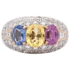1960s Yellow, Blue, Pink Sapphires with Diamonds Platinum Dome Three-Stone Ring