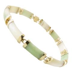 14 Karat Yellow Gold Green and White Jade Bracelet
