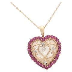 10 Karat Yellow Gold Ruby and Diamond Heart Pendant Necklace