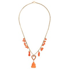 18 Karat Gold and Coral Buddha Charm Necklace