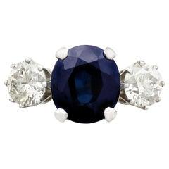 4.91 Carat Blue Sapphire 1.34 Carat Diamond Gold Trilogy Ring