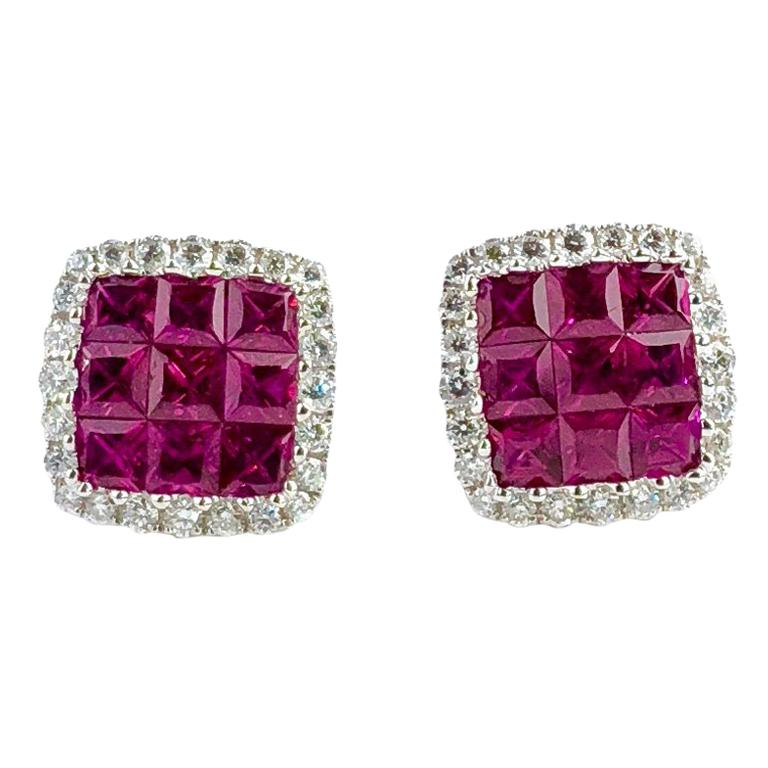 1.50 Carat Ruby and 0.29 Carat Diamond Halo Stud Earrings set in 18 Karat Gold For Sale