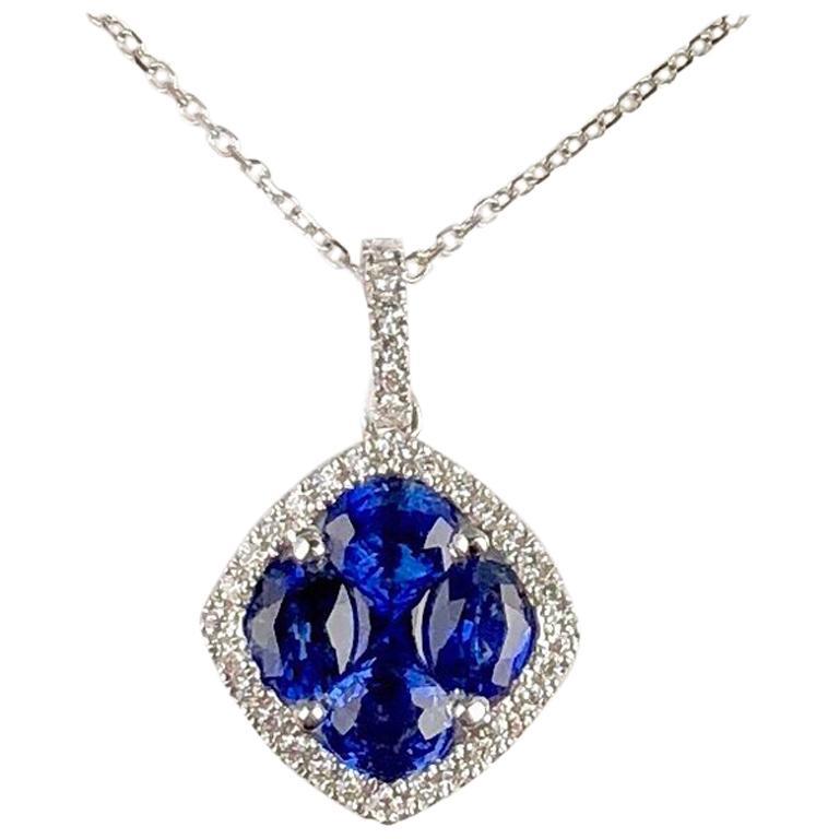 1.09 Carat Sapphire and 0.13 Carat Diamond Halo Pendant in 18 Karat White Gold For Sale