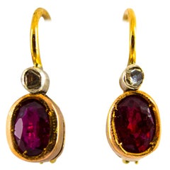 1.00 Carat Ruby 0.04 Carat White Diamond Yellow Gold Lever-Back Earrings