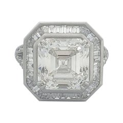 HRD Certified 6.90 Carat White Asscher Cut and Baguette Diamond Ring In 18 K.