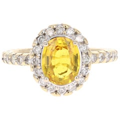 2.74 Carat Yellow Sapphire Diamond Halo 14 Karat Yellow Gold Ring