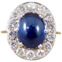 1930s 4 Carat Cabochon Sapphire and Diamond Cluster Ring in Unmarked 18Ct Gold