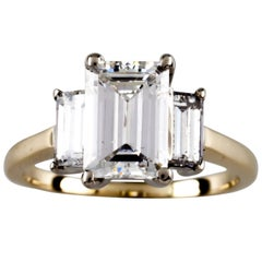 2.32 Carat Emerald Cut Diamond 14 Karat Yellow Gold Three-Stone Engagement Ring