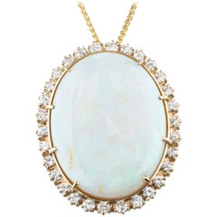 59.87 Carat Opal with Diamond Bezel Pendant 14 Karat Yellow Gold Necklace