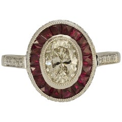 Vintage Inspired Platinum Ruby and Oval Diamond Ring