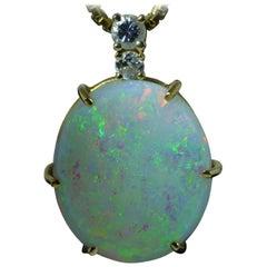 11 Carat Australian Opal Pendant in 14 Karat Yellow Gold Set with Diamonds