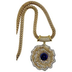 18 Karat Gold, 8.79 Carat Tanzanite, Yellow and White Diamond Flower Pendant