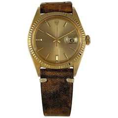 Rolex 18 Karat Yellow Gold Datejust Taupe Mirror Dial Wristwatch, 1960s