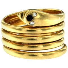 18 Karat Gold Diamond Coiled Snake Ring