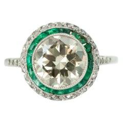 1920s Art Deco Old European Diamond, Emerald and Diamond Halo and Platinum Ring