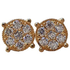 18 Karat Gold Stud Earrings are Set with 0.68 Carat of Diamond, Illusion Set