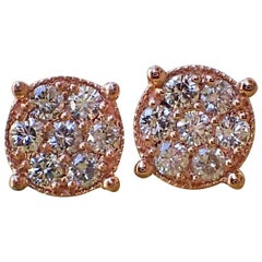 14 Karat Gold Stud Earrings are Set with 0.68 Carat of Diamond, Illusion Set