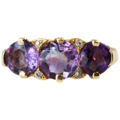 1890s Victorian Antique Three-Stone Amethyst, Diamond and 18 Karat Gold Ring