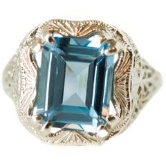 1920s Art Deco 3 Carat Blue Topaz and 14 Karat White Gold Filigree Ring