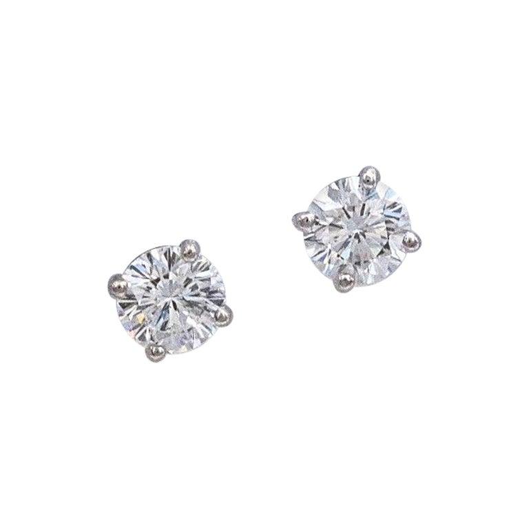 Leo Diamond Stud Earrings Rounds 0.98 Carat F-G SI 14 Karat White Gold For Sale