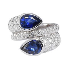 Contraire 18 Karat White Gold Ring with Sapphires and Diamonds