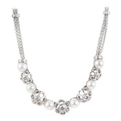 1980s Retro Floral Necklace with Pearls and Diamonds in 18 Karat White Gold