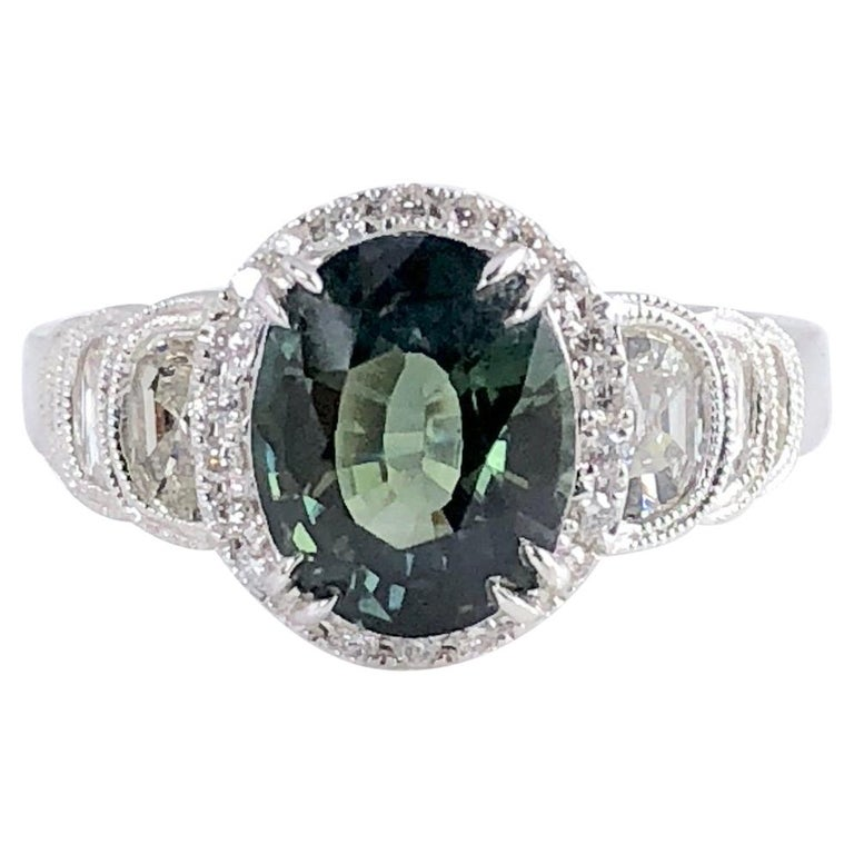 2.86 Carat Oval Cut Forest Green Sapphire and 0.87 Carat Diamond Ring For Sale