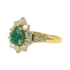 1990s Classic Engagement and Statement Emerald 18 Karat Gold Ring with Diamonds