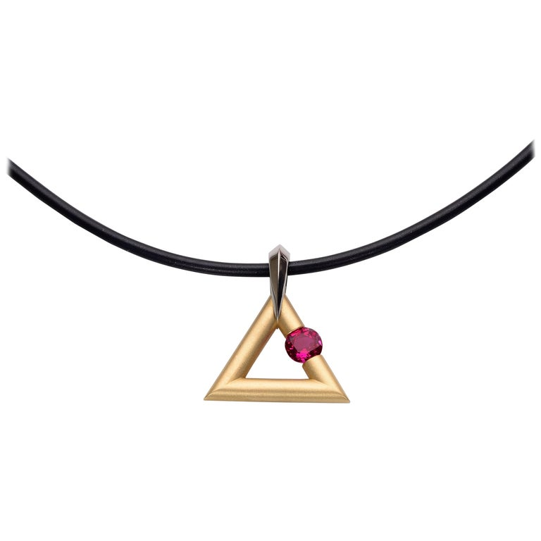 Steven Kretchmer 18K Yellow Gold Logo Pendant with a Tension-Set 0.63ct. Ruby  For Sale