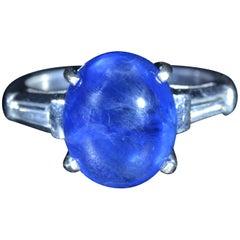 6.62 Carat Cabochon Sapphire Ring in Platinum Set with Baguette Cut Diamonds