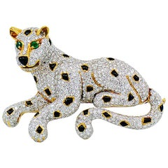Vintage Diamond Leopard Brooch 18 Karat White and Yellow Gold, Emerald and Onyx