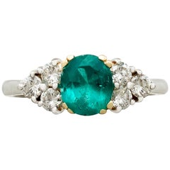 1990s 1.06 Carat Emerald and Diamond Platinum Cocktail Ring