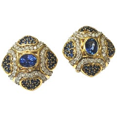 Blue Sapphire and Diamond Earrings Set in 18 Karat Yellow Gold with Oval Centers