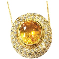 Handmade 18 Karat Yellow Gold and Diamond Pendant with a Center Yellow Sapphire