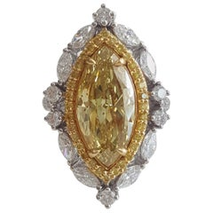 5.49 Carat Natural Yellow Marquise And White Diamond Ring In 18 K White Gold.