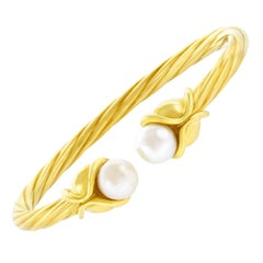 Gold Cable Twist Bangle by Mayors