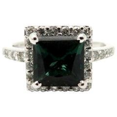Estate Vintage 18 Karat White Gold Green Tourmaline and Round Diamond Halo Ring
