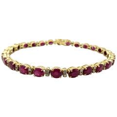 Estate Vintage Oval Ruby and Round Diamond 18 Karat Yellow Gold Tennis Bracelet