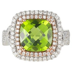 Jewels by Jacob White Gold and Peridot Ring with Rose Gold Accents