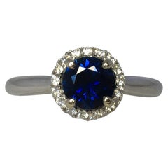 Australian Deep Blue Sapphire and Diamond 18 Karat Gold Halo Ring 1.00 Carat